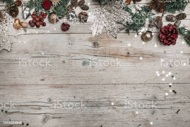 Christmas and autumnal gray wood background with decoration picture id1044034946?b=1&k=6&m=1044034946&s=612x612&h=lmzmbs ztikd226usy7wzhtka4h7ntxkjofsamfynee=