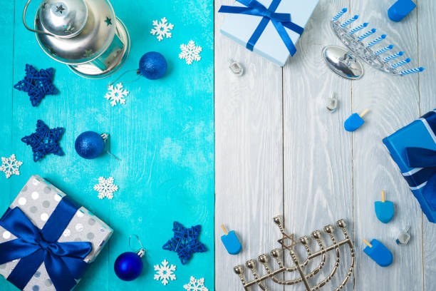 christmas and hanukkah celebration concept. winter holidays background with gift boxes and traditional decorations. - hanukkah stock pictures, royalty-free photos & images