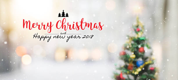 christmas and happy new year 2018 on blurred bokeh christmas tree with snowfall background. - christmas stock photos and pictures