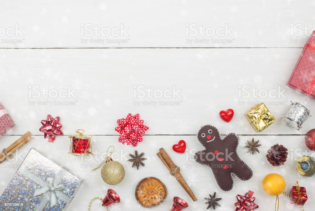 Christmas and Happy new year object decoration flat lay with copy space on white wooden table background with snowfall.Gifts and congratulations concept. stock photo