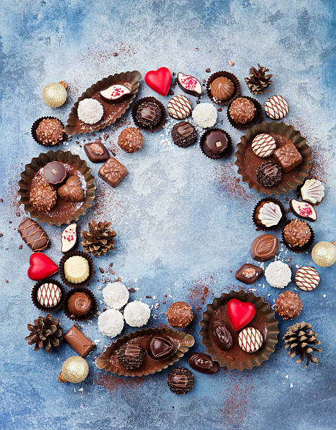 christmas and new year background mix of chocolate - chocolate christmas - fotografias e filmes do acervo