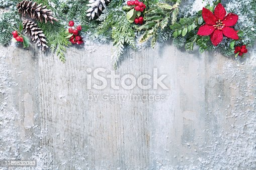 istock Christmas and New Year background with fir branches and snowfall on wooden white board 1189832083