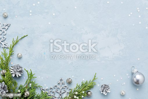 istock Christmas and New Year background with frame of silver decorations on blue copy space. 1054261846