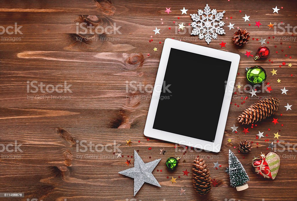 Christmas and New year background with tablet and decorations. stock photo