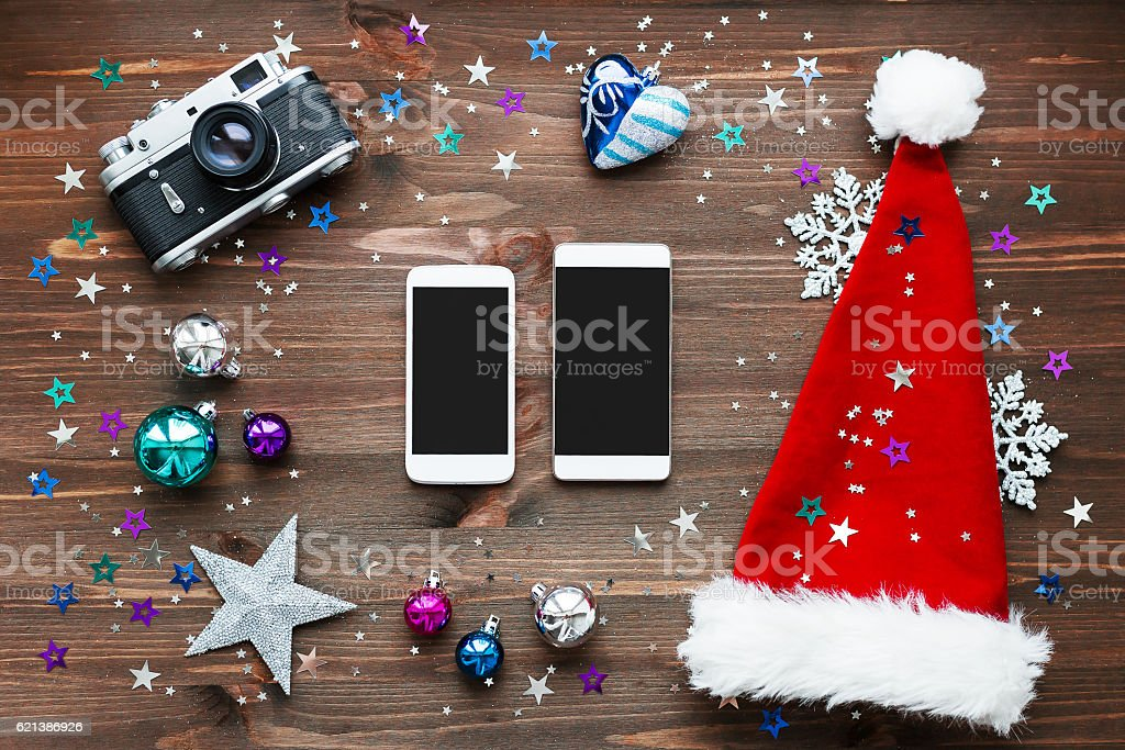 Christmas and New Year background with two smartphones stock photo