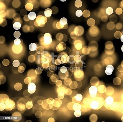 505891526istockphoto Christmas and New Year bokeh light holiday background. Abstract gold bokeh light on black color background illustration. 1188395311