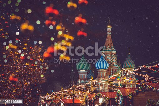 Christmas village in winter at the Red square near GUM, St. Basil's Cathedral and Kremlin in Moscow, Russia