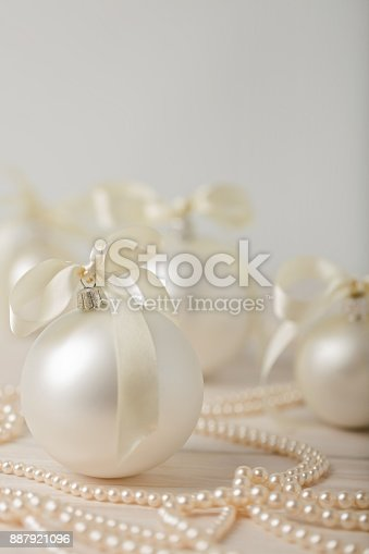 istock Christmas and New Year. Christmas tree white toys with ribbon. 887921096