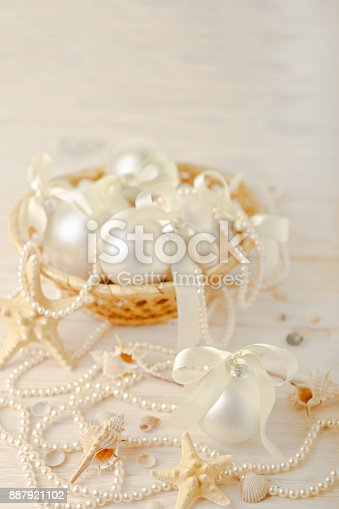 istock Christmas and New Year. Christmas-tree white toys in a marine style, seashells stones and starfish. 887921102