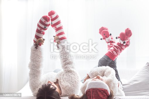 istock Christmas and new year concept, mom and daughter play 1066323676
