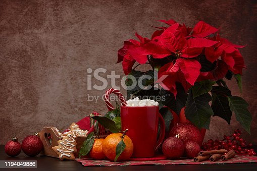istock Christmas and New Year decorations and treat: gingerbread, cocoa with marshmallow and mandarins. 1194049886