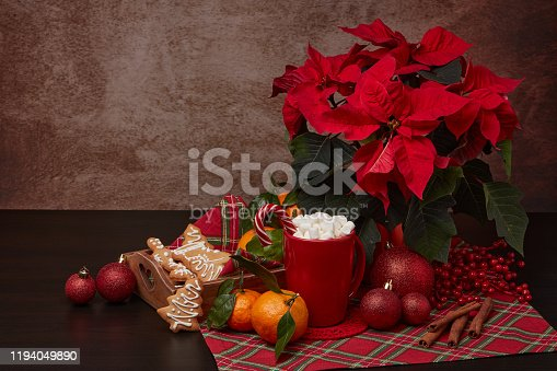 istock Christmas and New Year decorations and treat: gingerbread, cocoa with marshmallow and mandarins. 1194049890