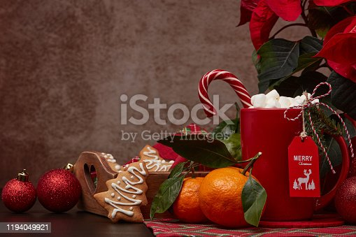 istock Christmas and New Year decorations and treat: gingerbread, cocoa with marshmallow and mandarins. 1194049921