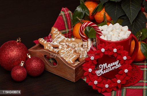 istock Christmas and New Year decorations and treat: gingerbread, cocoa with marshmallow and mandarins. 1194049974