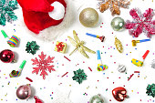 istock Christmas and New Year decorations with confetti, gift boxes, Santa Claus hat and party blowouts. Colorful party flat lay. 1288069271