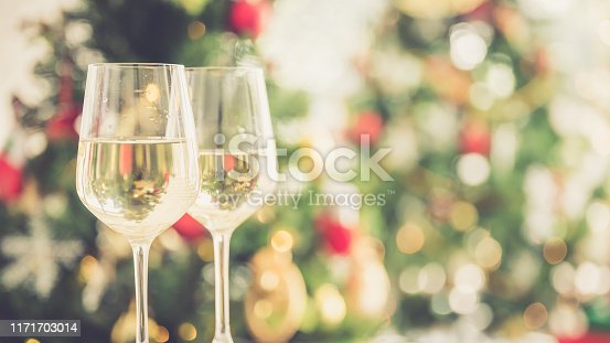 istock Christmas and new year eve party with champagne and blurred background ornament decorated tree 1171703014