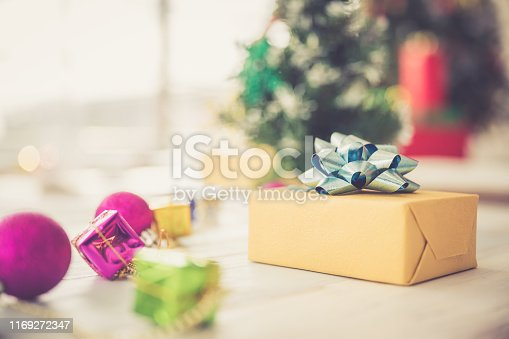 istock Christmas and new year eve theme and gift box on blurred background 1169272347