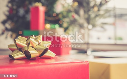 istock Christmas and new year eve theme and gift box on blurred background 1173135901