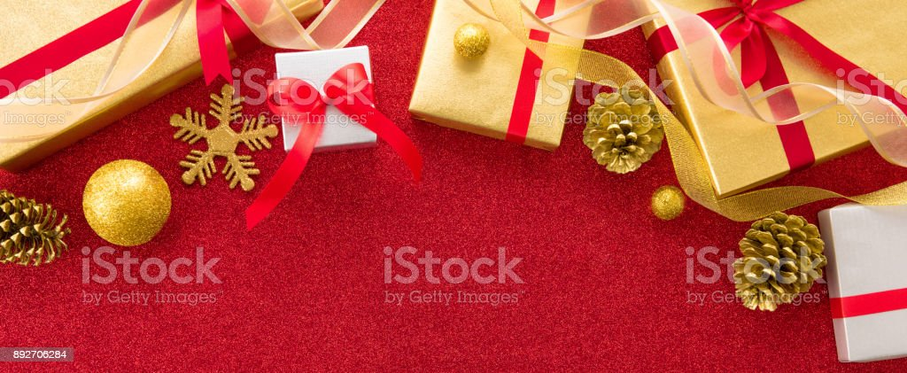 christmas and new year gift boxes with decorating items on red banner background royalty free