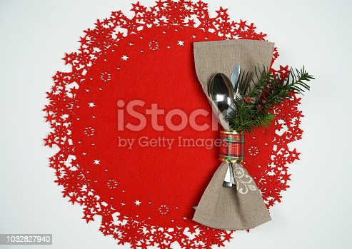 istock Christmas And New Year Holiday Table Place Setting with branch of Christmas tree. Red woolen and white background. Winter holidays concept 1032827940