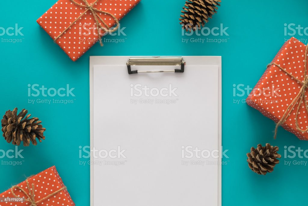 Christmas and New Year holiday to do list with notepad, gift boxes,...