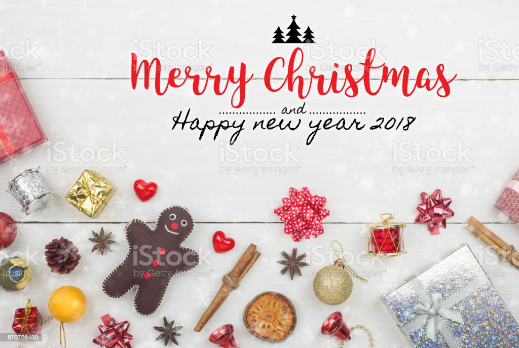 Christmas and New Year holidays gift box with decorative ornament on white wooden table with falling snow effect.Flat lay with Merry Christmas & New Year 2018 sign.Gifts and congratulations concept. stock photo