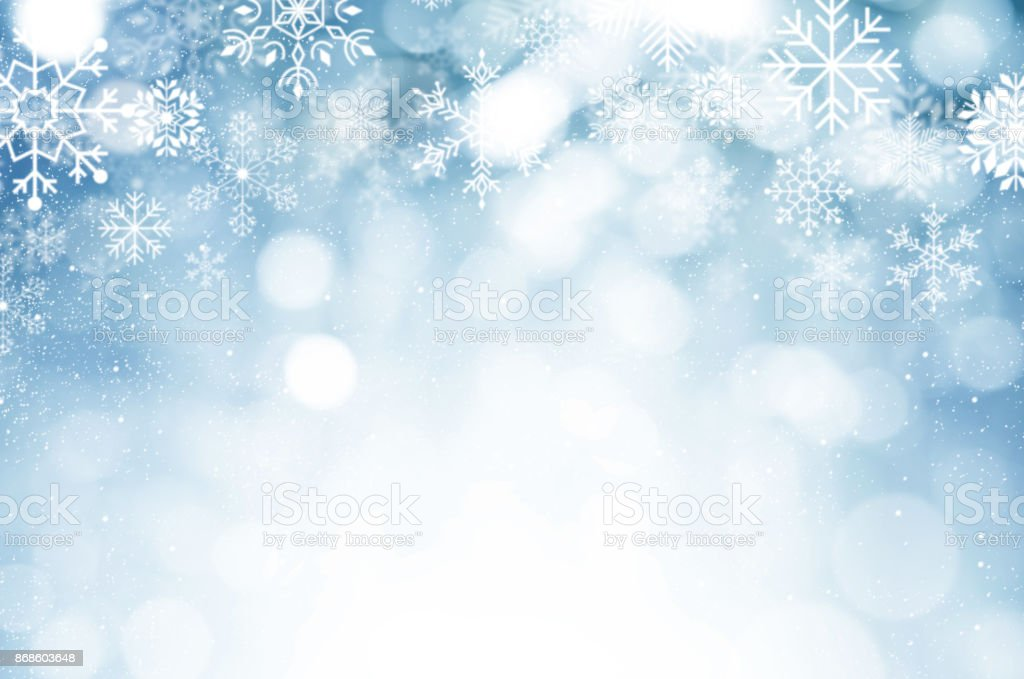 christmas and new year theme background blue blurred abstract background with snowflake royalty