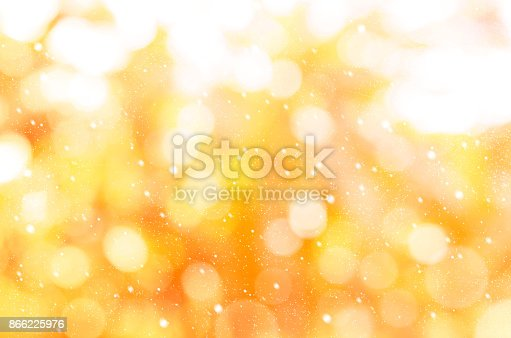 istock Christmas and New year theme background. Golden abstract with winter snowfall background. 866225976