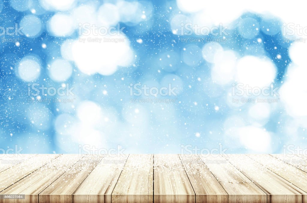 christmas and new year theme background wooden table with abstract winter snowfall can be