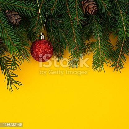 istock Christmas and New Year yellow background 1186232145