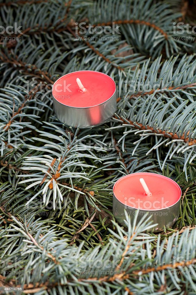 Christmas and New Year's candle on the background spruce, close-up royalty-free stock photo