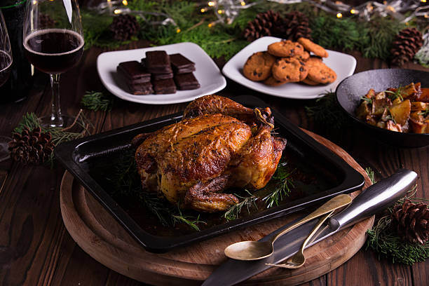 Christmas and new year's eve dinner: roasted whole chicken stock photo