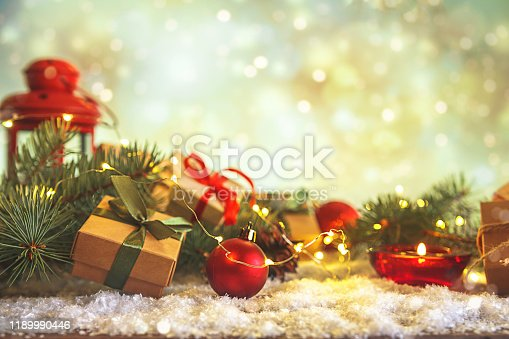 istock Christmas and zero waste, eco friendly packaging gifts in kraft paper on a wooden table, eco christmas holiday concept, eco decor banner 1189990446