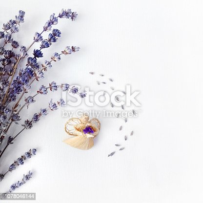 Christmas angel and lavender, composition on a white canvas, conceptual background for a holiday card, top view.