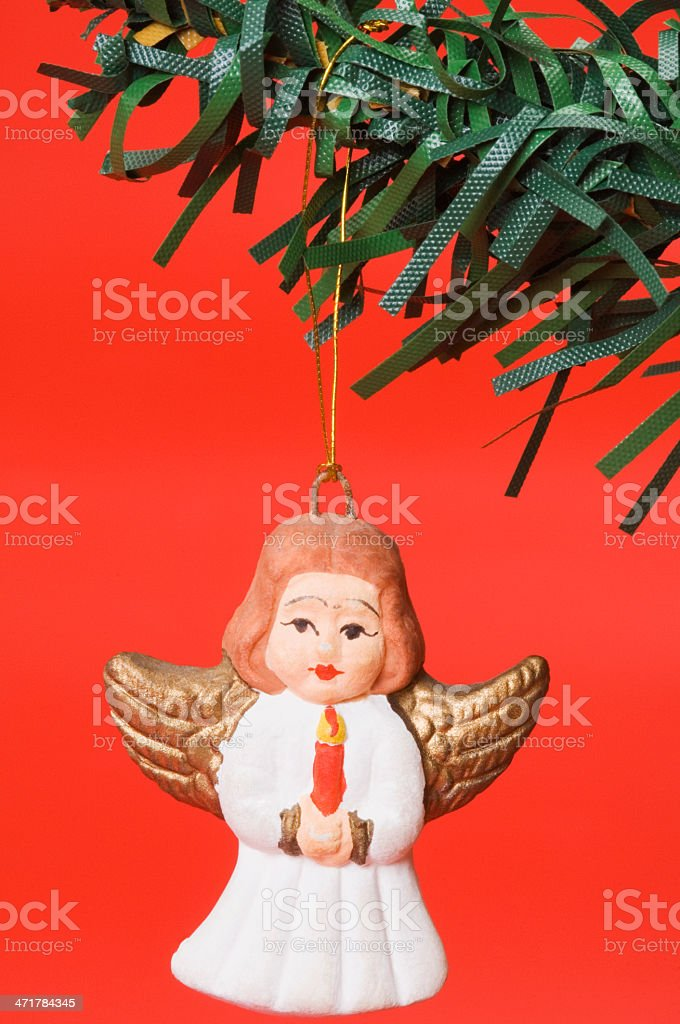 Christmas angel figurine hanging on a Christmastree royalty-free stock photo
