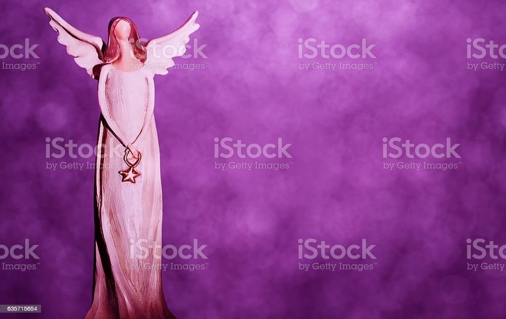 Christmas angel on a purple bokeh background royalty-free stock photo