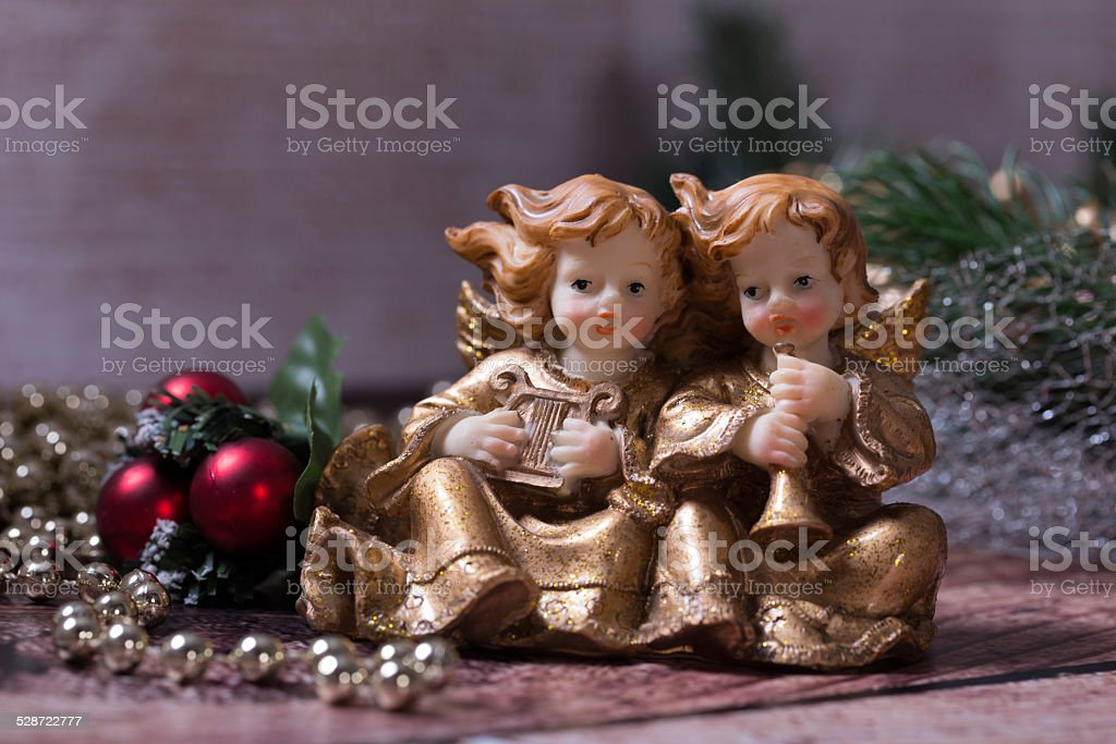 Christmas angels singing and playing on the harp and trumpet stock photo