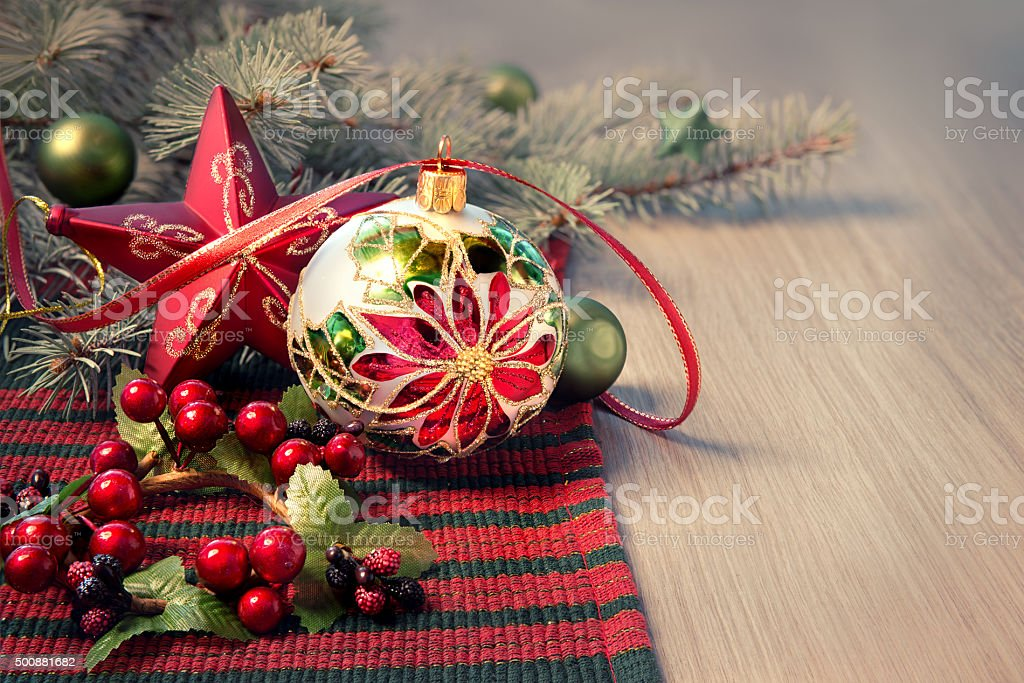 Christmas arrangement in red and green on wood stock photo