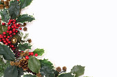 istock Christmas arrangement of green leaves and red berries 186222160