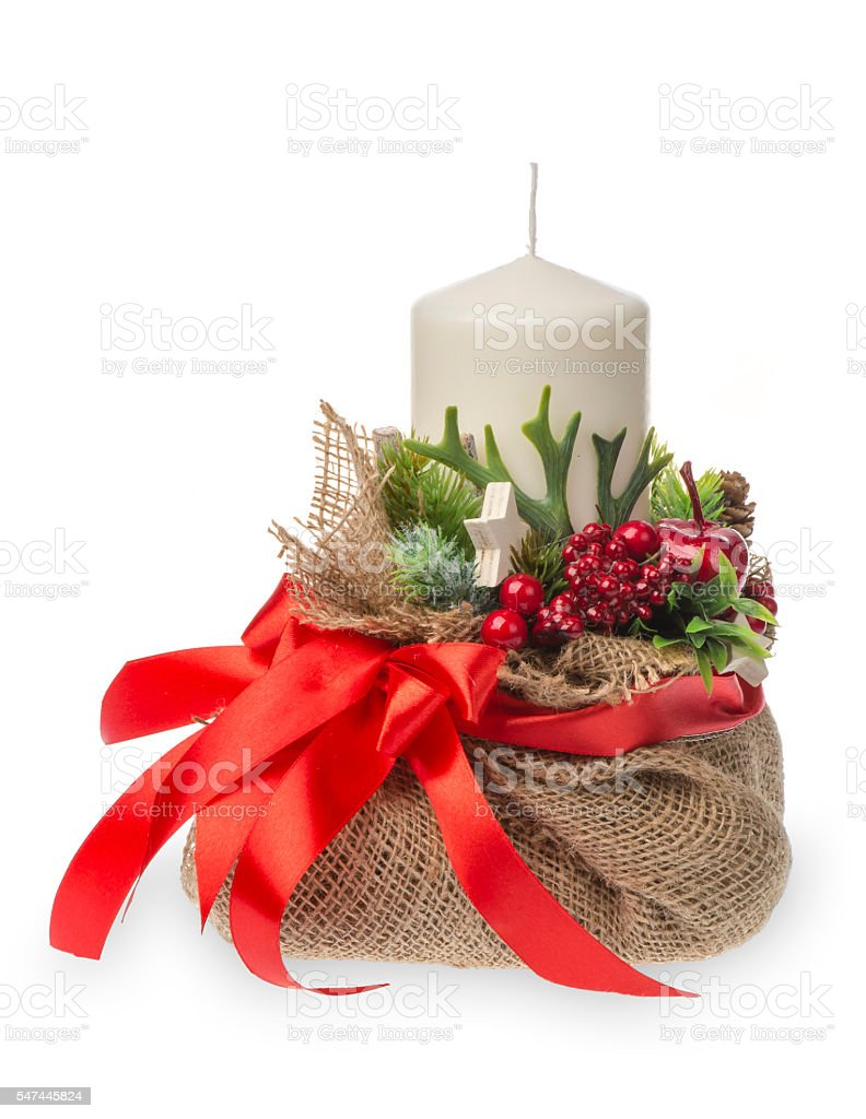 Christmas arrangement- sackcloth bag with candle, ribbon and berries isolated. stock photo