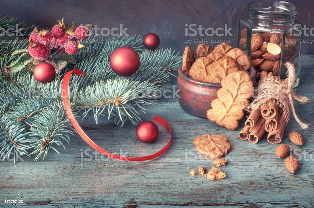 Christmas Arrangement With Almond Leaf Cookies In Green And Red