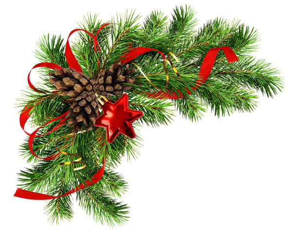 Christmas arrangement with pine twigs, cones and red silk ribbon bow stock photo