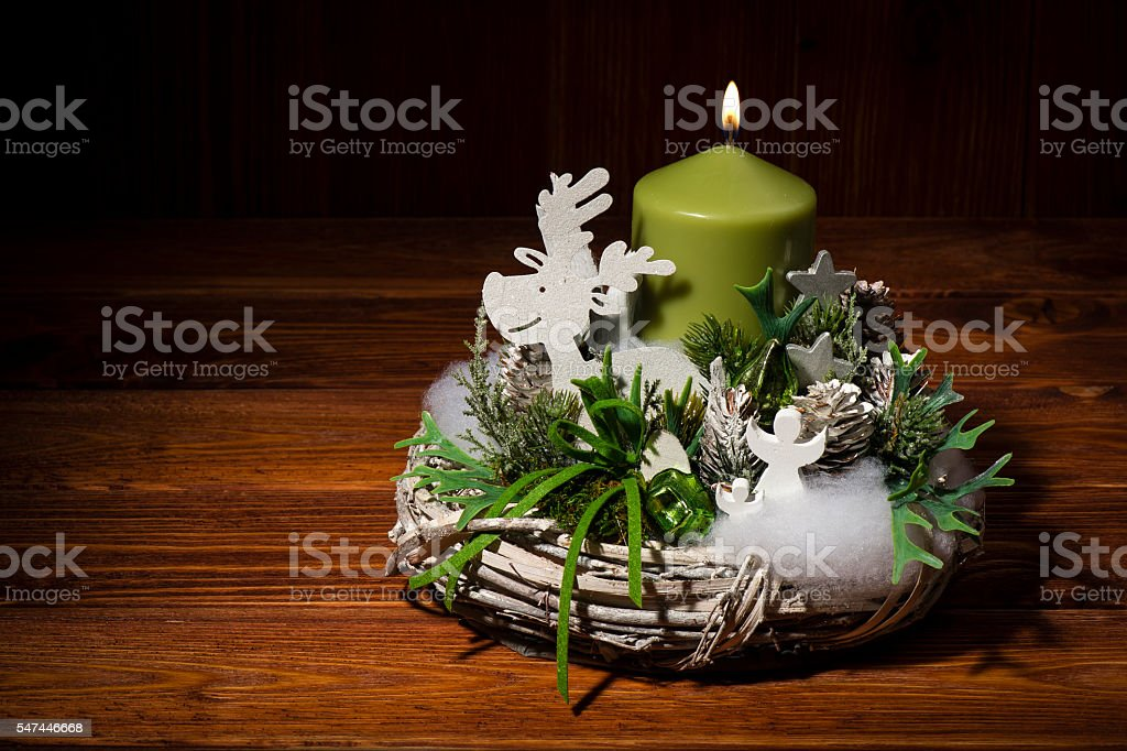 Christmas arrangement -wreath with candle on wooden background. stock photo