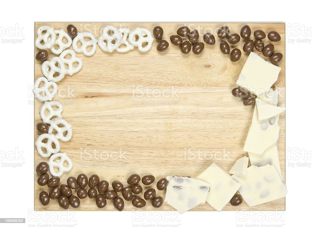 Christmas assortment of chocolate candies on a wooden surface stock photo