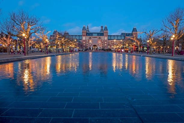 Christmas at the Museumplein in Amsterdam the Netherlands at twilight Christmas at the Museumplein in Amsterdam the Netherlands at twilight rijksmuseum stock pictures, royalty-free photos & images