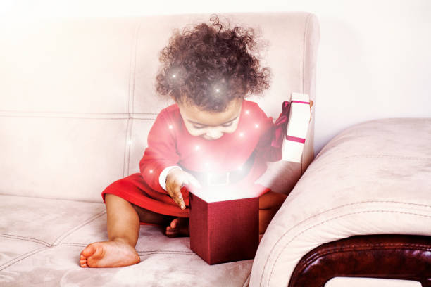 christmas baby and present - magician stock photos and pictures