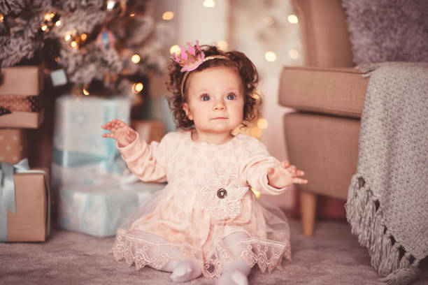 Christmas baby in room stock photo