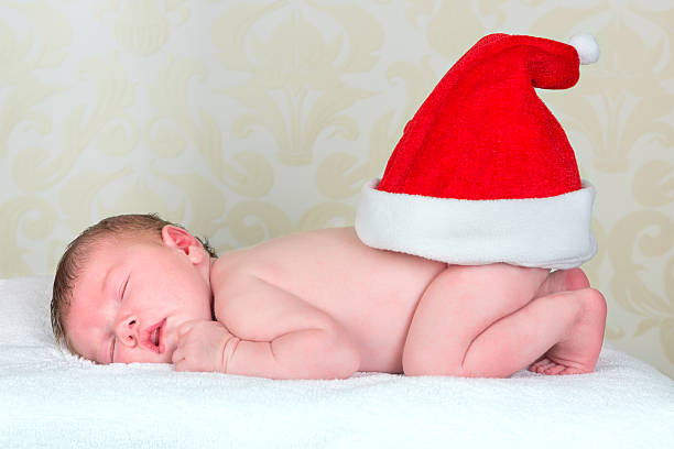 christmas baby - naked santa claus stock pictures, royalty-free photos & images