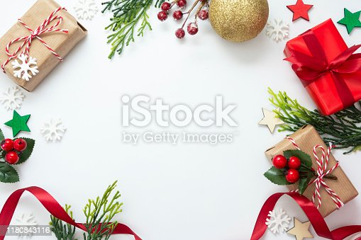 Christmas backgrond with gift boxes, red ribbon, winter decorations, isolated on white background. Christmas and New year concept. Mock up, copy space. Flat lay.