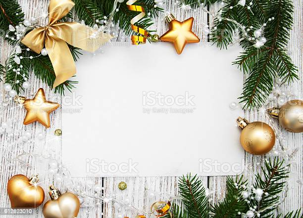 Photo of christmas background - blank paper with decoration